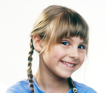 Young Girl with Pigtails Grinning - sm