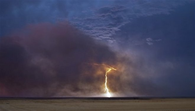 Lightning on Land Over Ocean - Copy