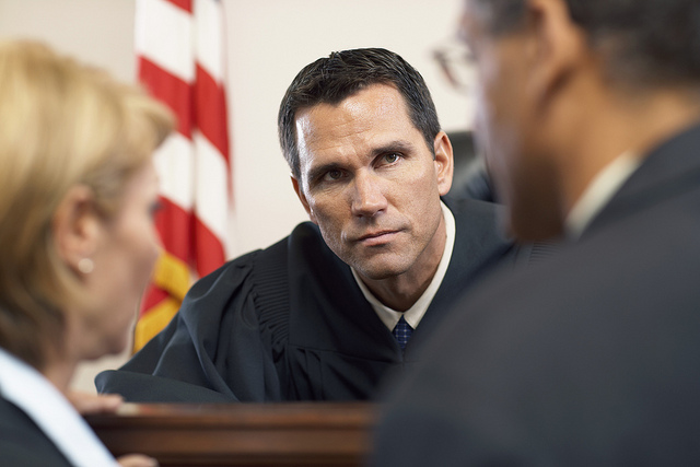 Judge Listening to Attorney --- Image by © Tim Pannell/Corbis