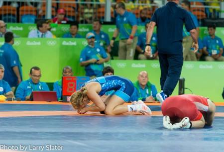 Joy and Sorrow on the Gold Medal Mat by Larry Slater