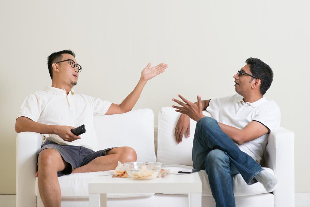 Male friends arguing